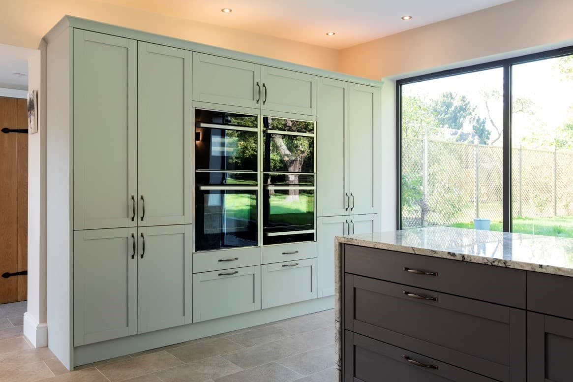 pebble grey fitted kitchen cabinets with integrated appliances