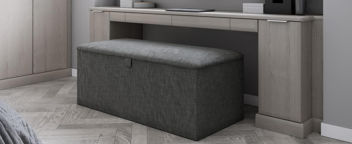 The new upholstered storage ottoman in a Hammonds fitted bedroom