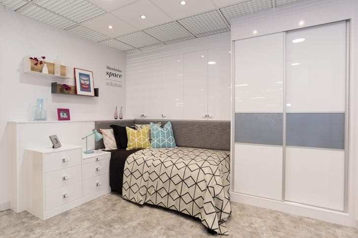 white 3 piece gloss sliding wardrobes on display