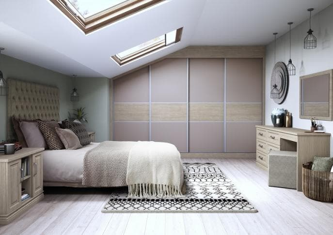 Matt sliding wardrobe doors in fudge made with Aragon oak