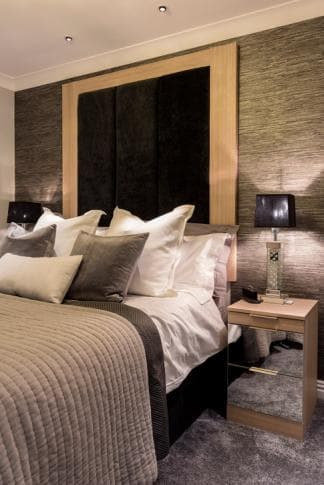 Light pine fitted furniture with matching headboard