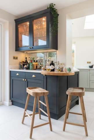 Croft kitchen with drinks cabinet and bar stools