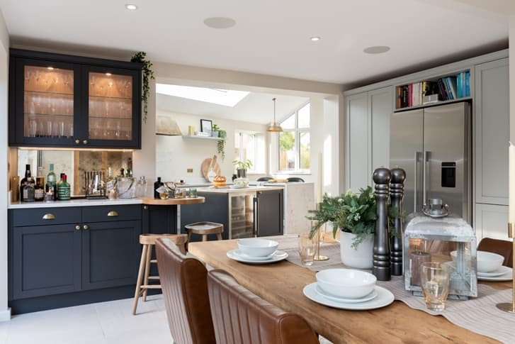 croft kitchen with dining table and drinks cabinets
