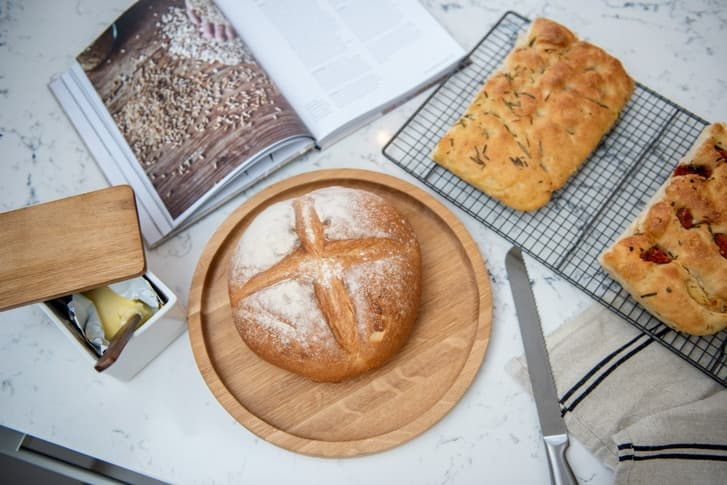 Croft kitchen focusing on worktops with freshly baked bread and recipe book