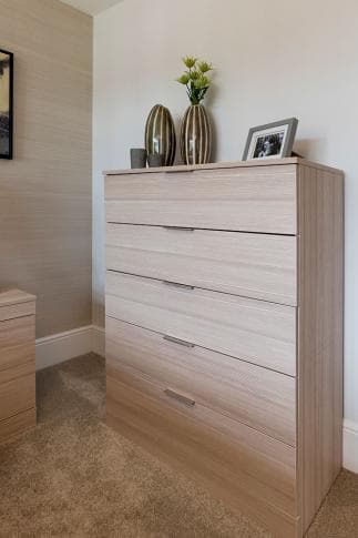 Hammonds chest of drawers in oak with accessories on top