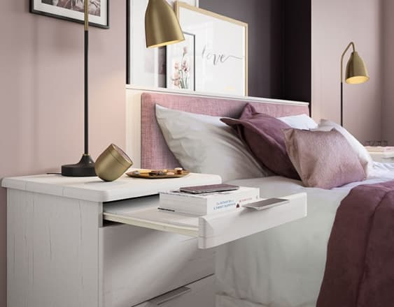 White bedside table in an avon fitted bedroom