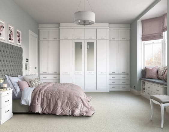 a white seton fitted wardrobes within a full bedroom landscape image